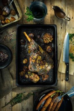 Food photo of roasted lamb leg with roasted vegetables