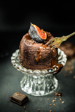 Yummy food photography of melted chocolate pudding with fig