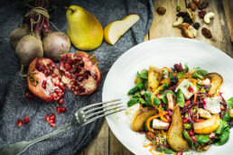 Food Photography, photo of salad with poached pear and nuts and pomegranit